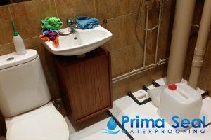 bathroom-sink-clutter-prepare-for-hacking-waterproofing-services-bathroom-waterproofing-primaseal-singapore