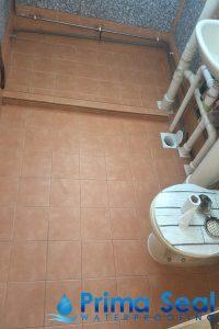 orange-tiled-waterproofed-bathroom-benefits-of-waterproofing-prima-seal-waterproofing-everyworks-singapore